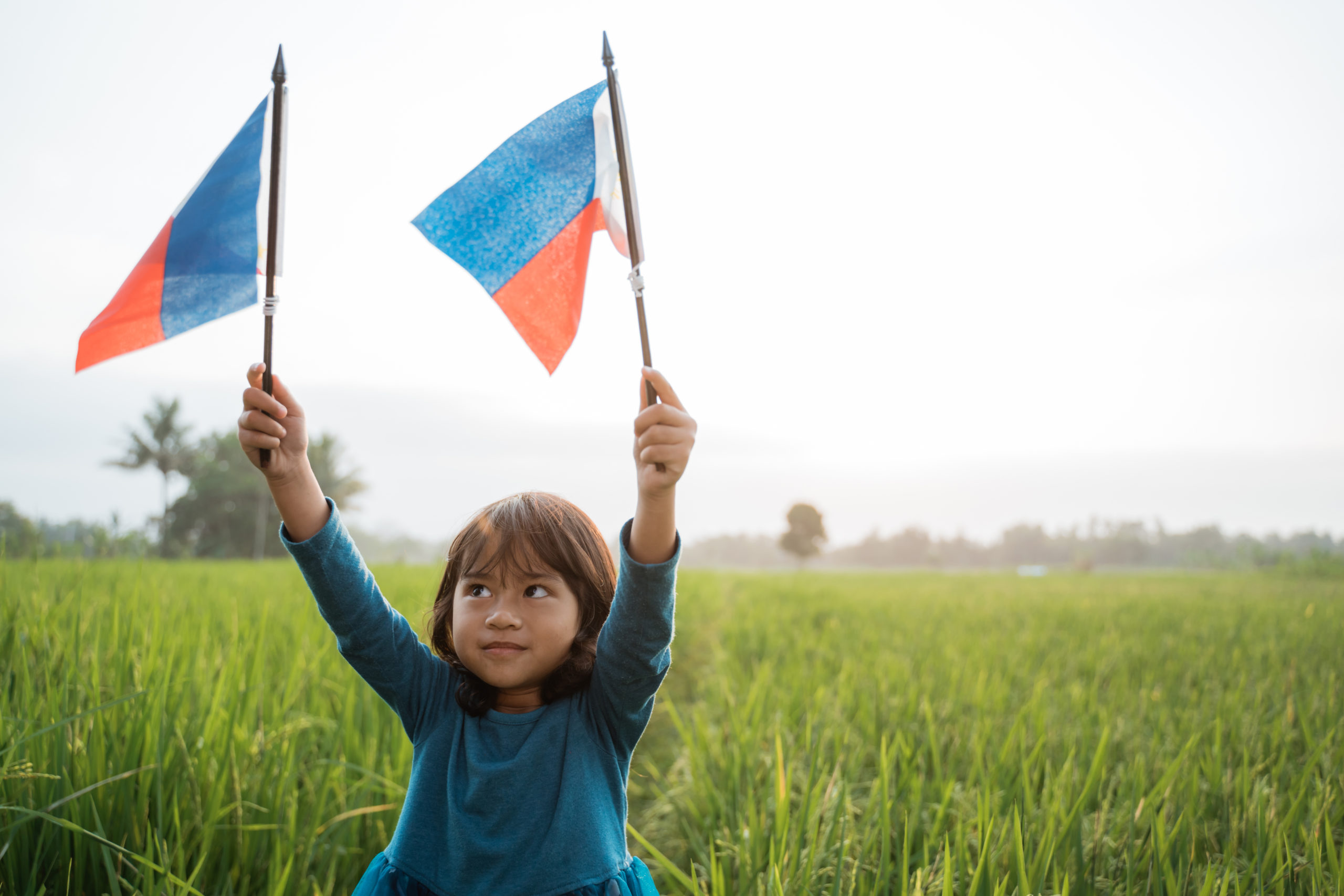 Phillipines girl with national flag