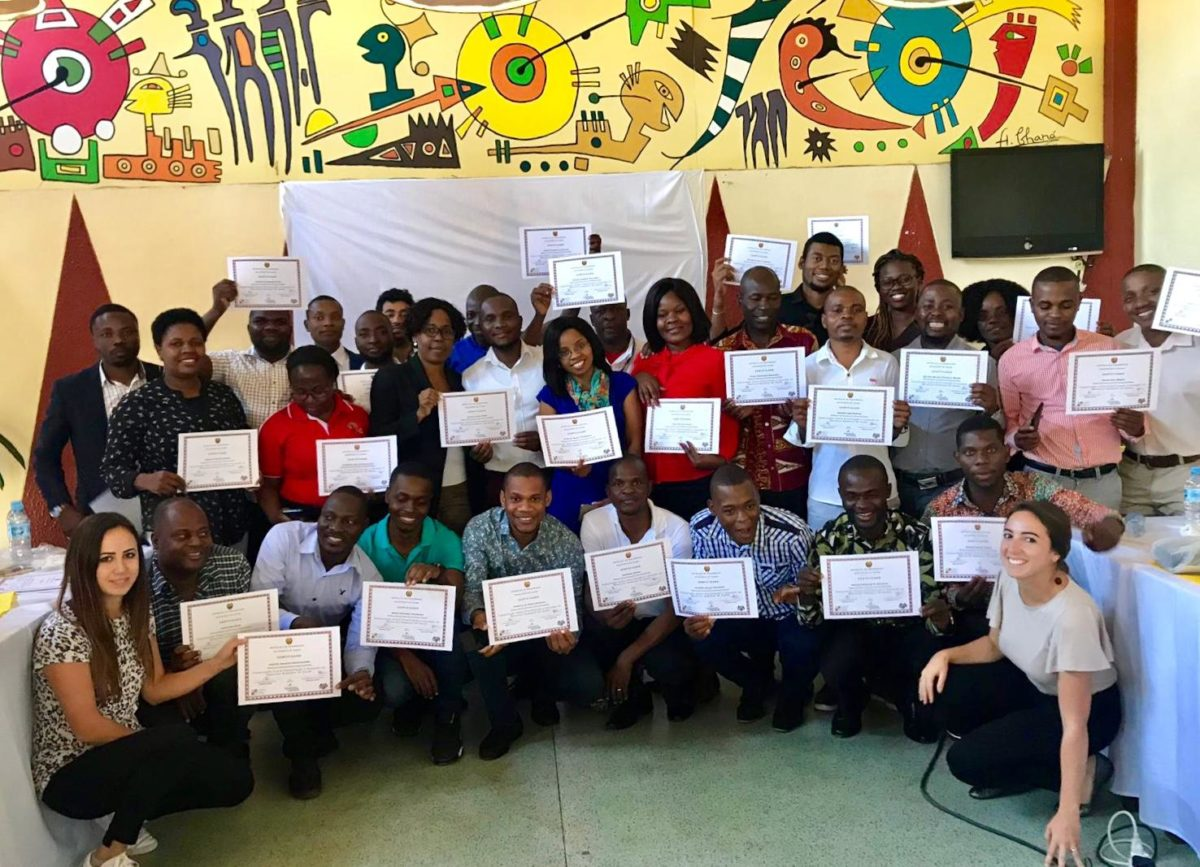 Group of Mozambican training participants with completion certificates