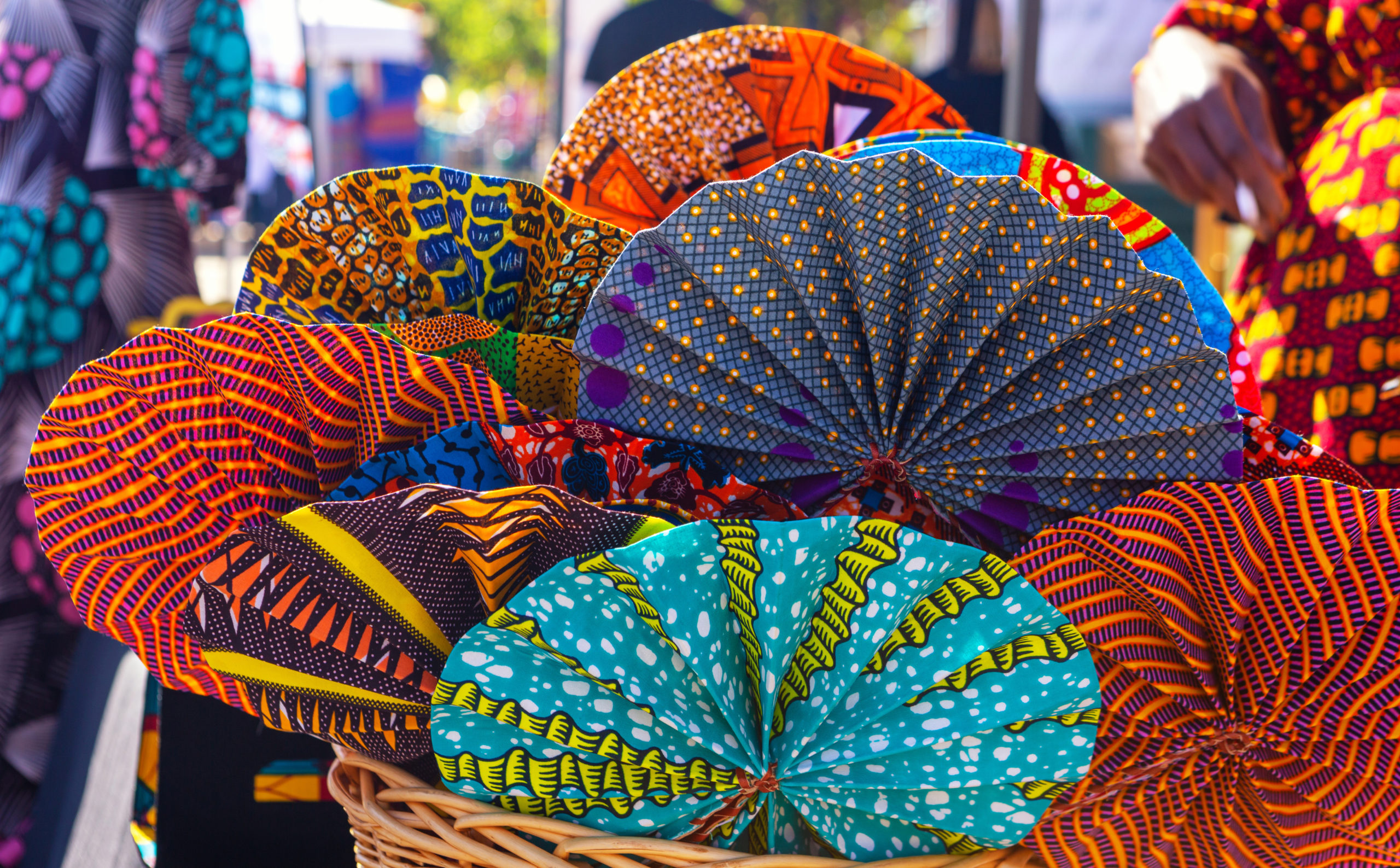 West African Fabric Fans at an Outdoor Market