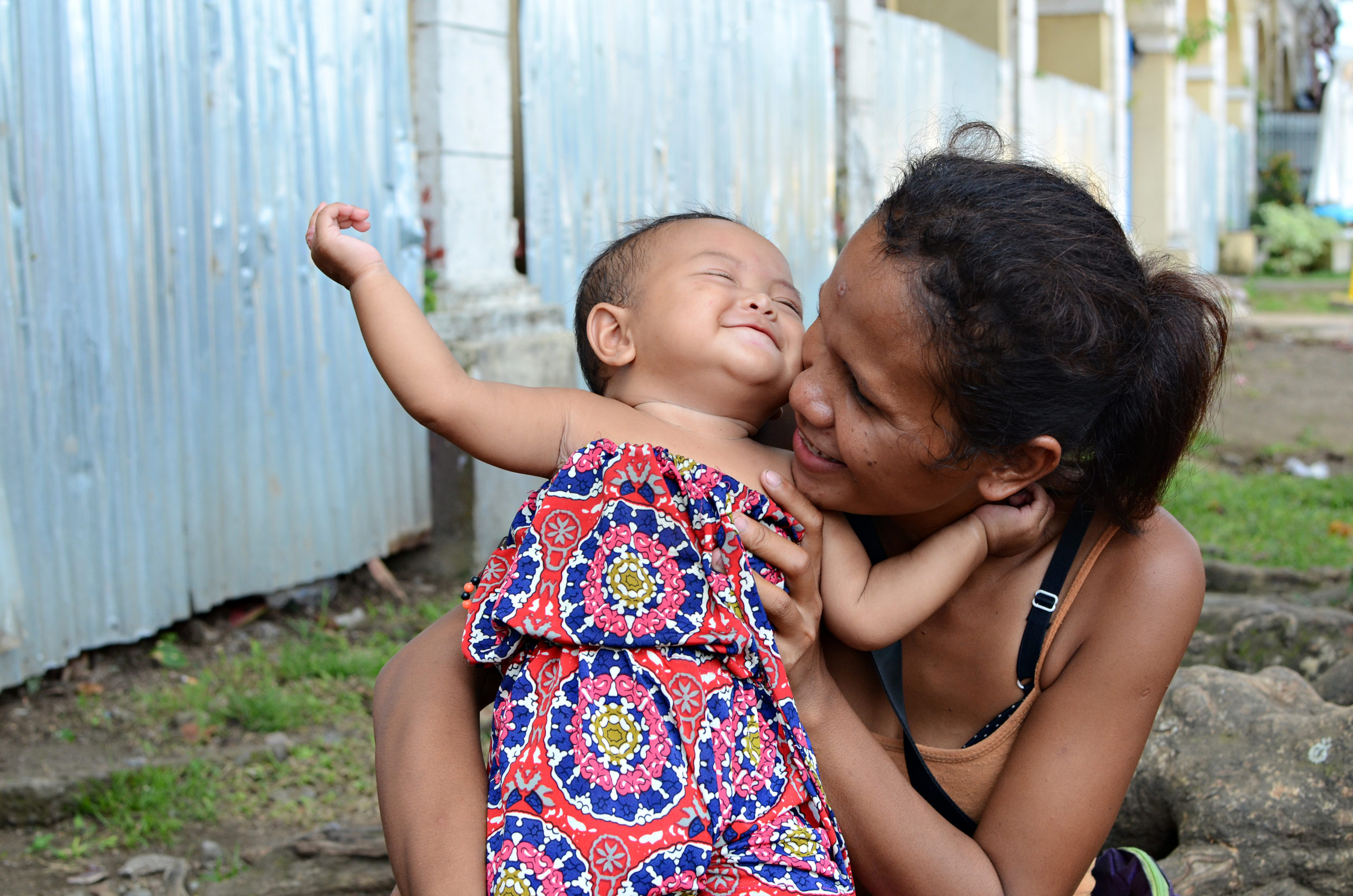 Philippines mother with happy baby
